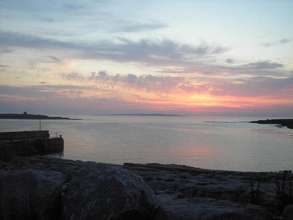 Doolin sunset over the Atlantic ocean and Aran Islands